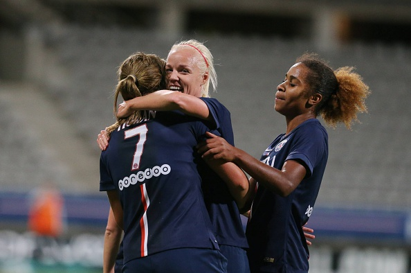 PARIS, FRANCE - OCTOBER 04:  Lindsey Horan of Paris Saint-Germain celebrates his goal with Caroline Seger during the Women Division 1 between Paris Saint-Germain FC and FCF Juvisy Essonne at Charlety on october 4, 2014 in Paris, France.  (Photo by Xavier Laine/Bongarts/Getty Images)