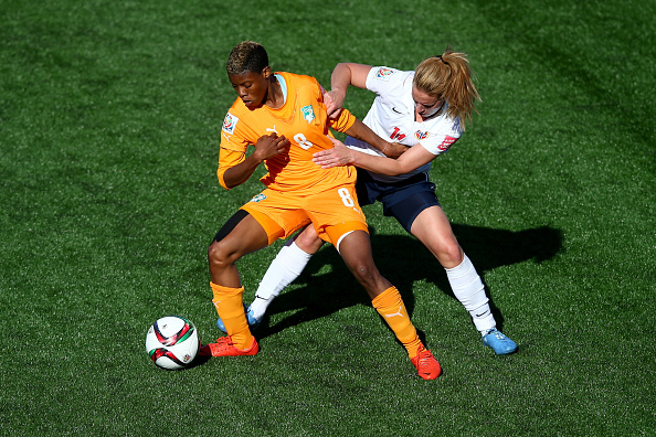 MONCTON, NB - JUNE 15:  Ingrid Schjelderup of Norway challanges Ines Nrehy of Cote D'Ivoire during the FIFA Women's World Cup 2015 Group B match between Cote D'Ivoire and Norway at Moncton Stadium on June 15, 2015 in Moncton, Canada.  (Photo by Clive Rose - FIFA/FIFA via Getty Images)