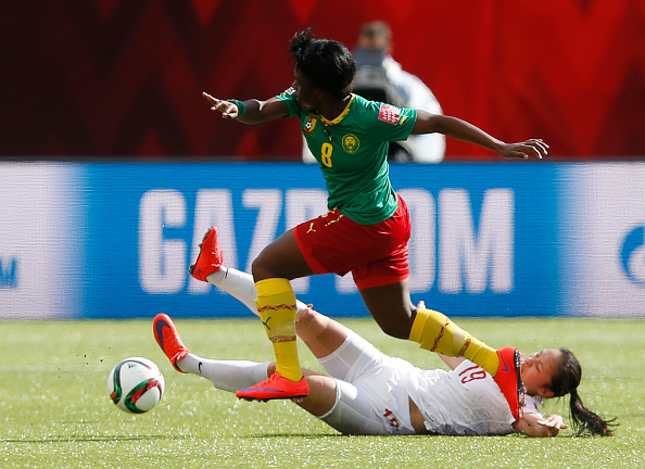 EDMONTON, AB - JUNE 20: Tan Ruyin #19 of China gets knocked over by Raissa Feudjio #8 of Cameroon during the FIFA Women's World Cup Canada Round 16 match between China and Cameroon at Commonwealth Stadium on June 20, 2015 in Edmonton, Alberta, Canada.  (Photo by Todd Korol/Getty Images)