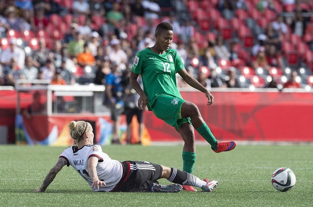 Germany's Anja Mittag tackles Ivory Coast's Ida Guehai  during a Group B match at the 2015 FIFA Women's World Cup at Landsdowne Stadium in Ottawa on June 7, 2015.    AFP PHOTO/NICHOLAS KAMMNICHOLAS KAMM/AFP/Getty Images ORG XMIT: 528449131